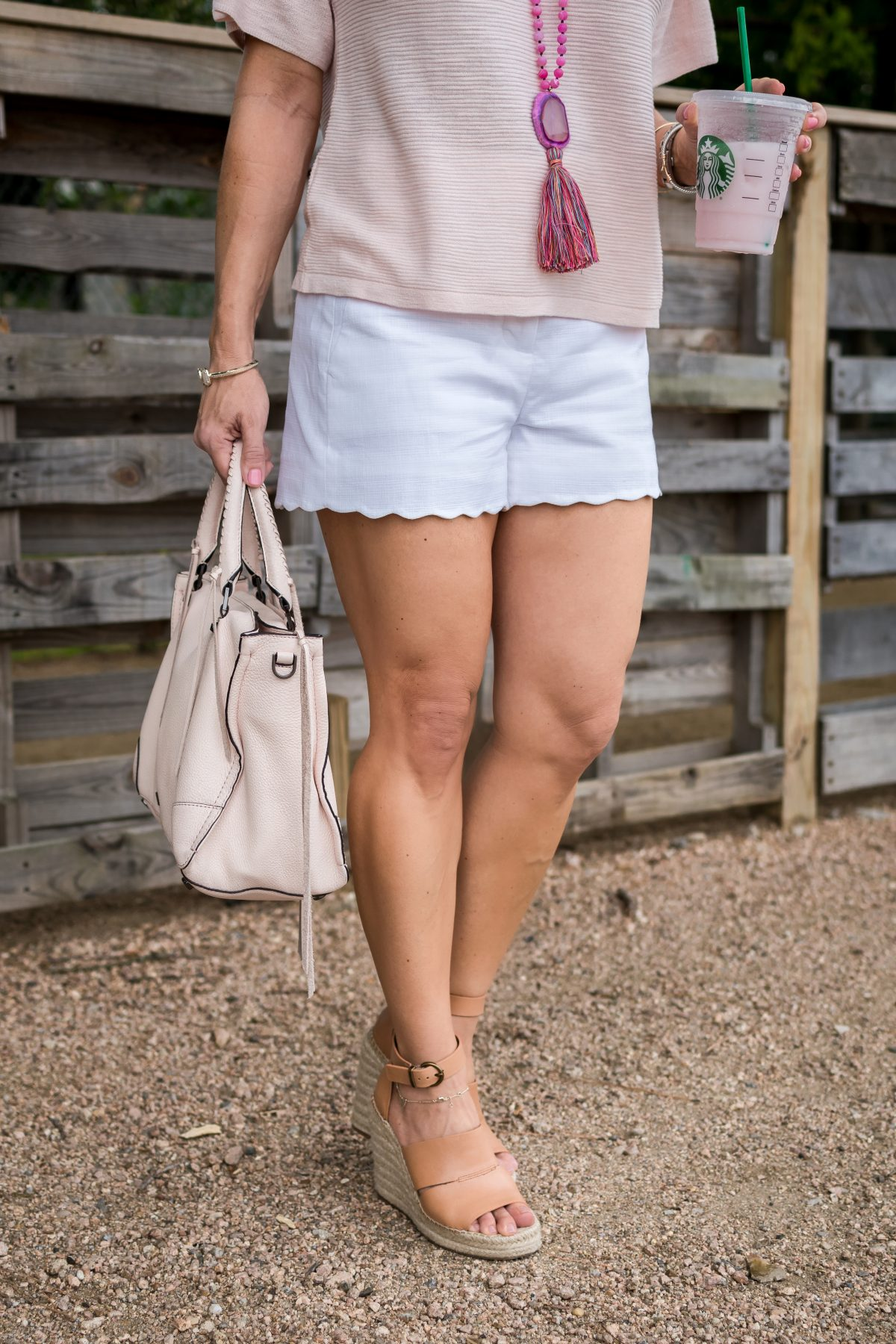 Weekend Outfit- pink flutter sleeve top with white scallop shorts and pink necklace and wedges