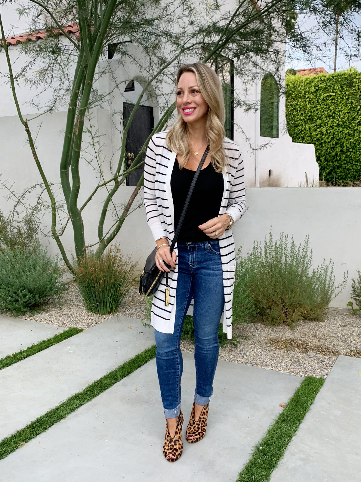 Cute Fall Outfit - long striped cardigan jeans and leopard booties