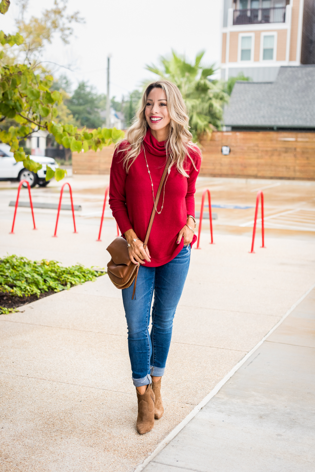 Cute Fall Outfit with red pullover, jeans and booties