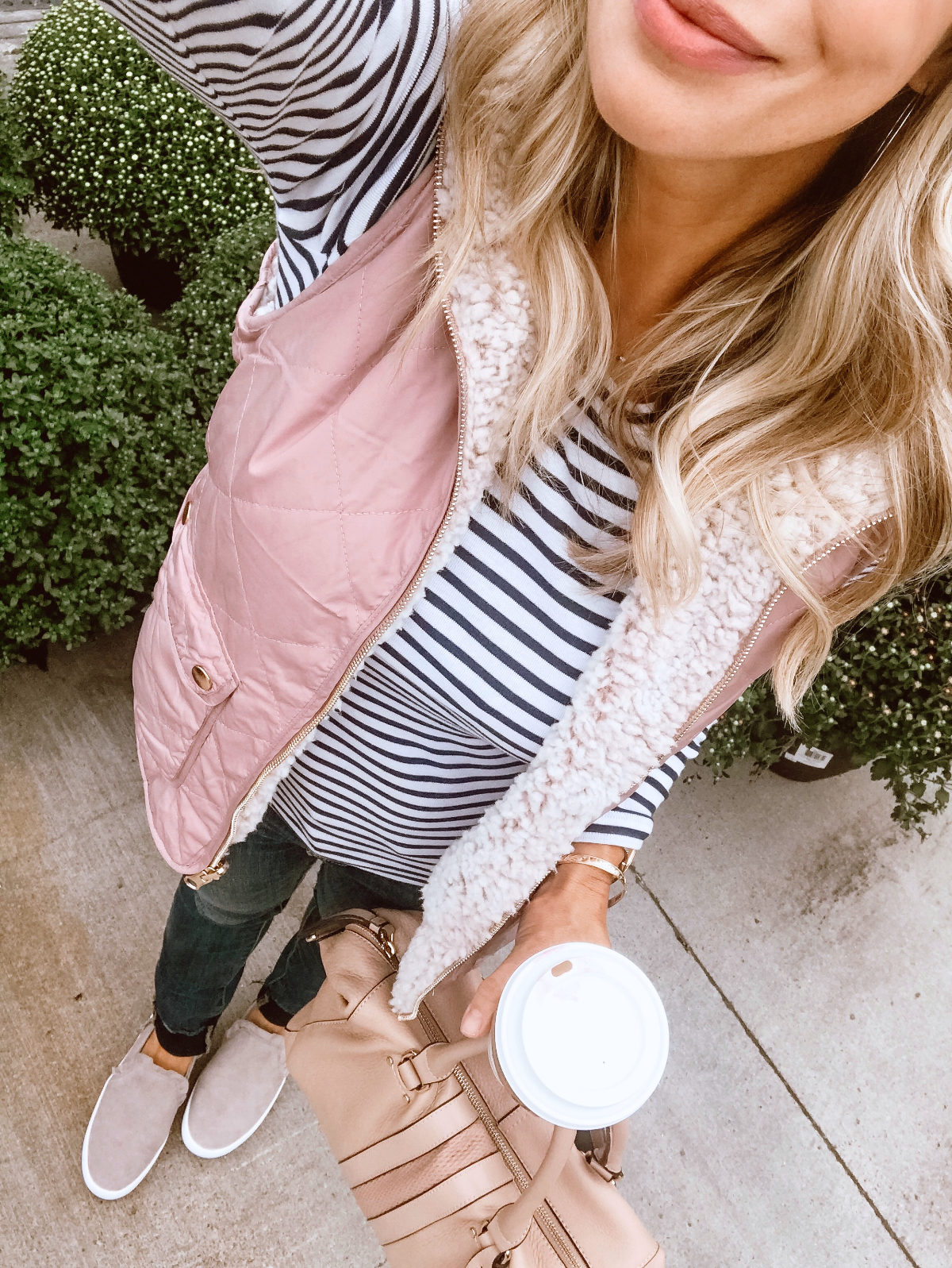 Fall Outfit Inspiration - puffer vest and striped top with jeans and sneakers
