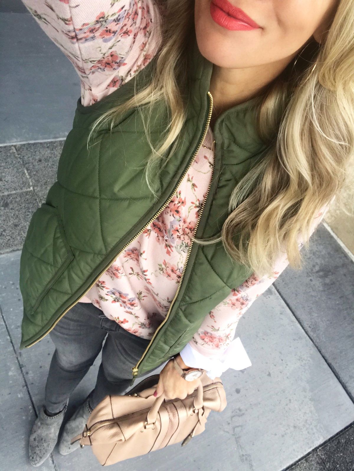 Fall Outfit Inspiration - puffer vest and sweatshirt with jeans and booties