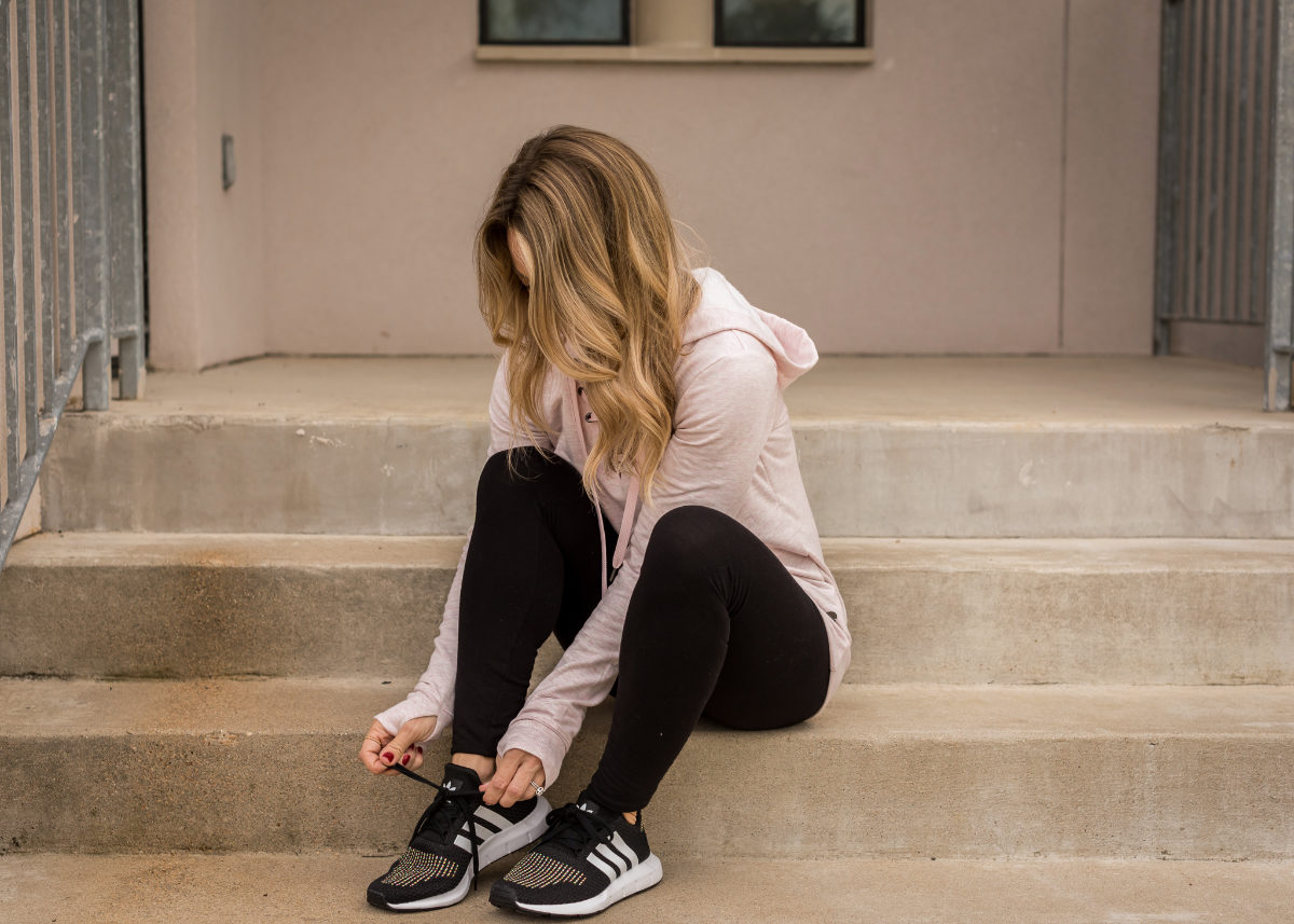 Cute Athleisure outfit with lace up hoodie and Adidas sneakers
