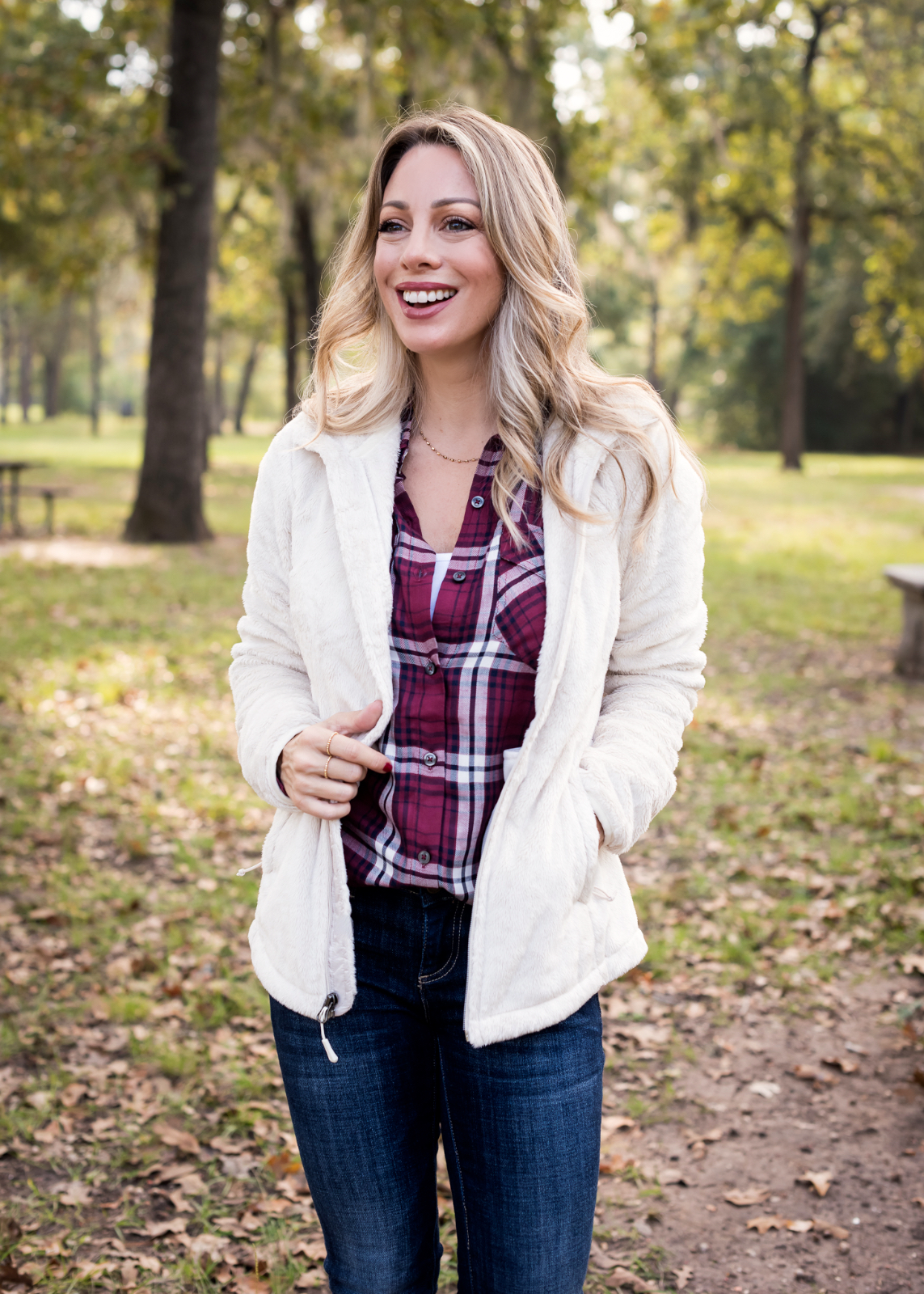Cute Fall Outfit North Face Jacket plaid top jeans and booties