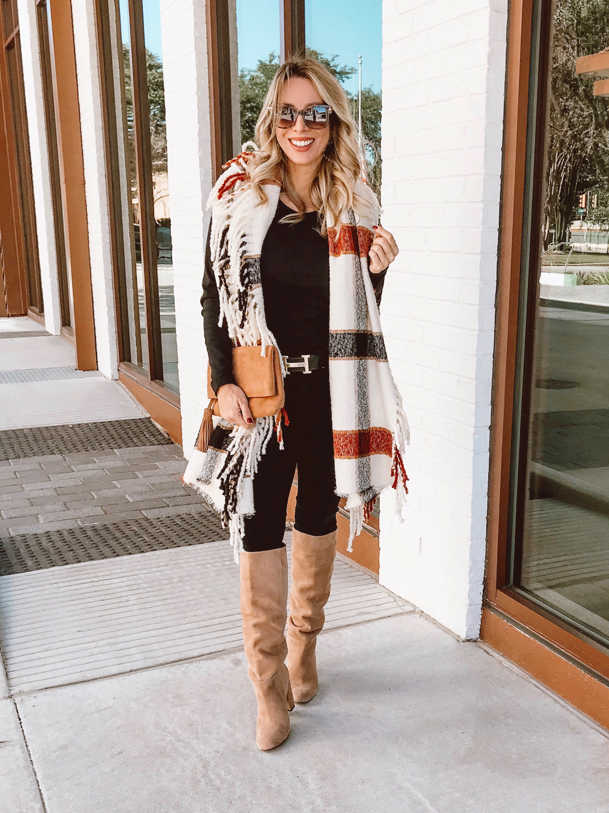 Winter outfit - fringe scarf black jeans and tall boots