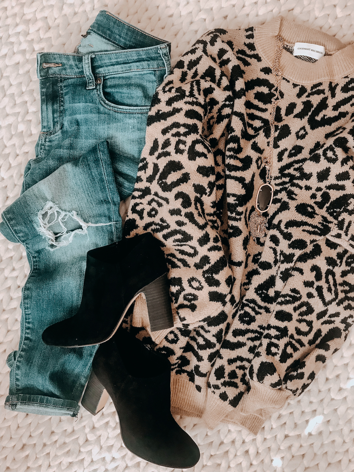 Winter outfit - leopard sweater jeans and black booties