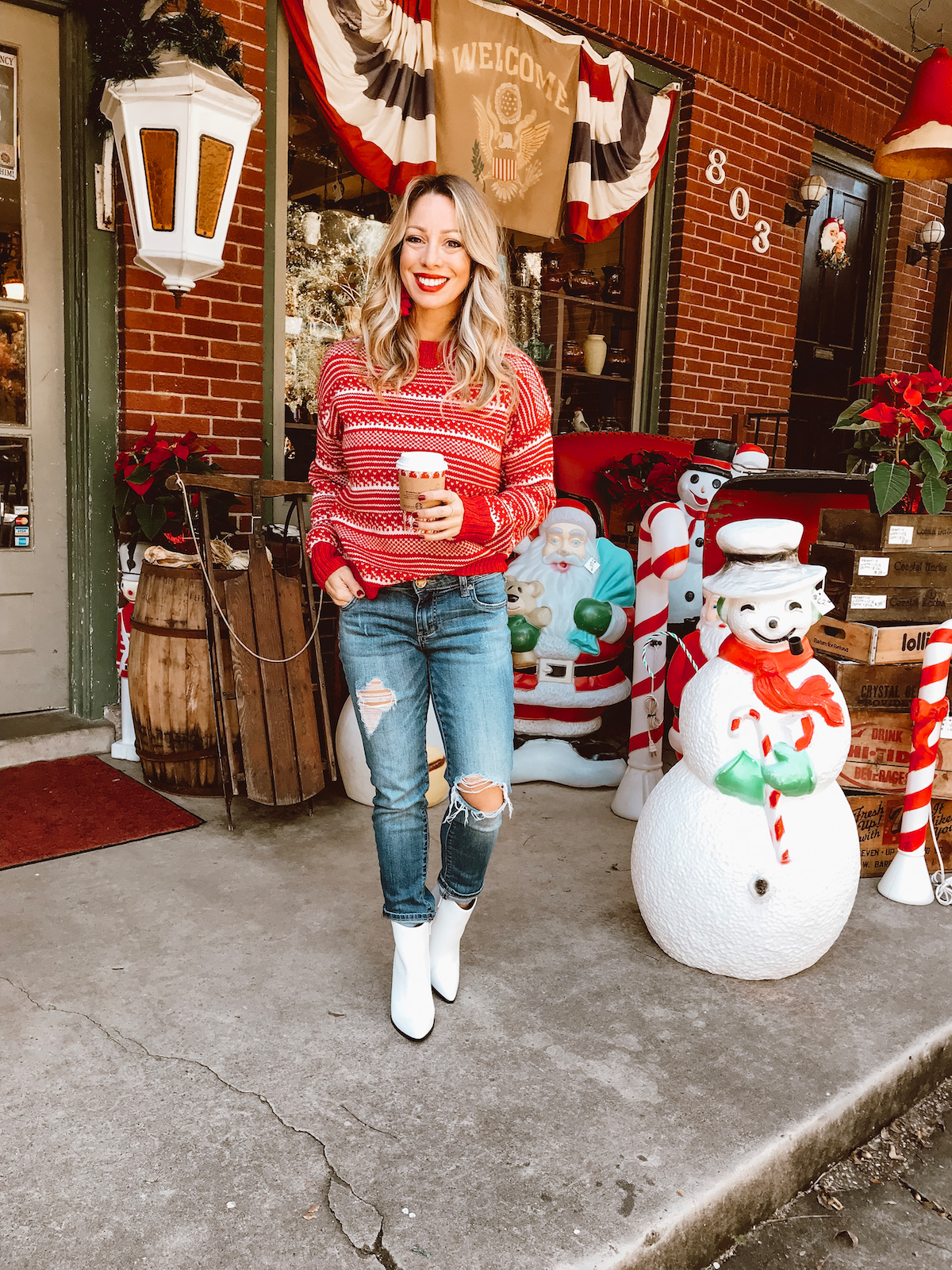 Winter outfit - red sweater ripped jeans white booties