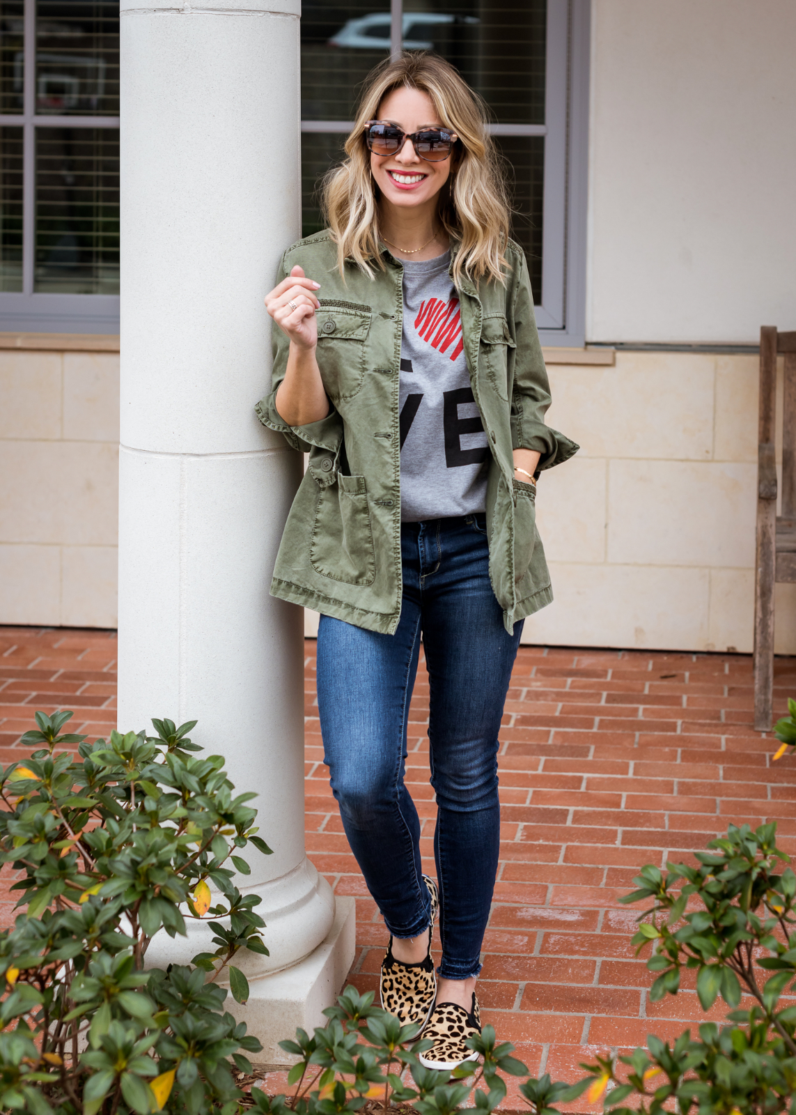 Cute winter outfit - LOVE tee military jacket and skinny jeans