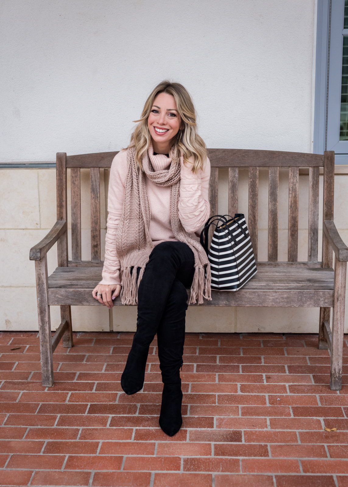 Cute winter outfit - pink sweater and black jeans