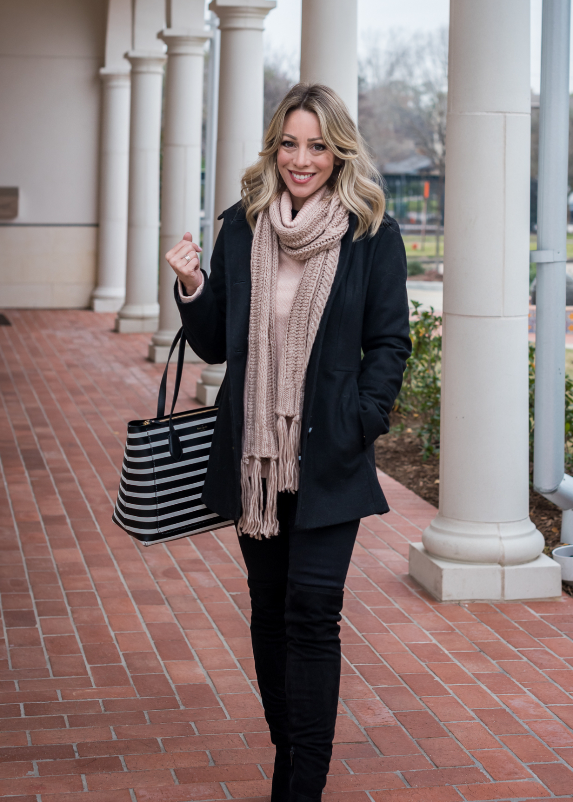 Cute winter outfit with peacoat and pink scarf