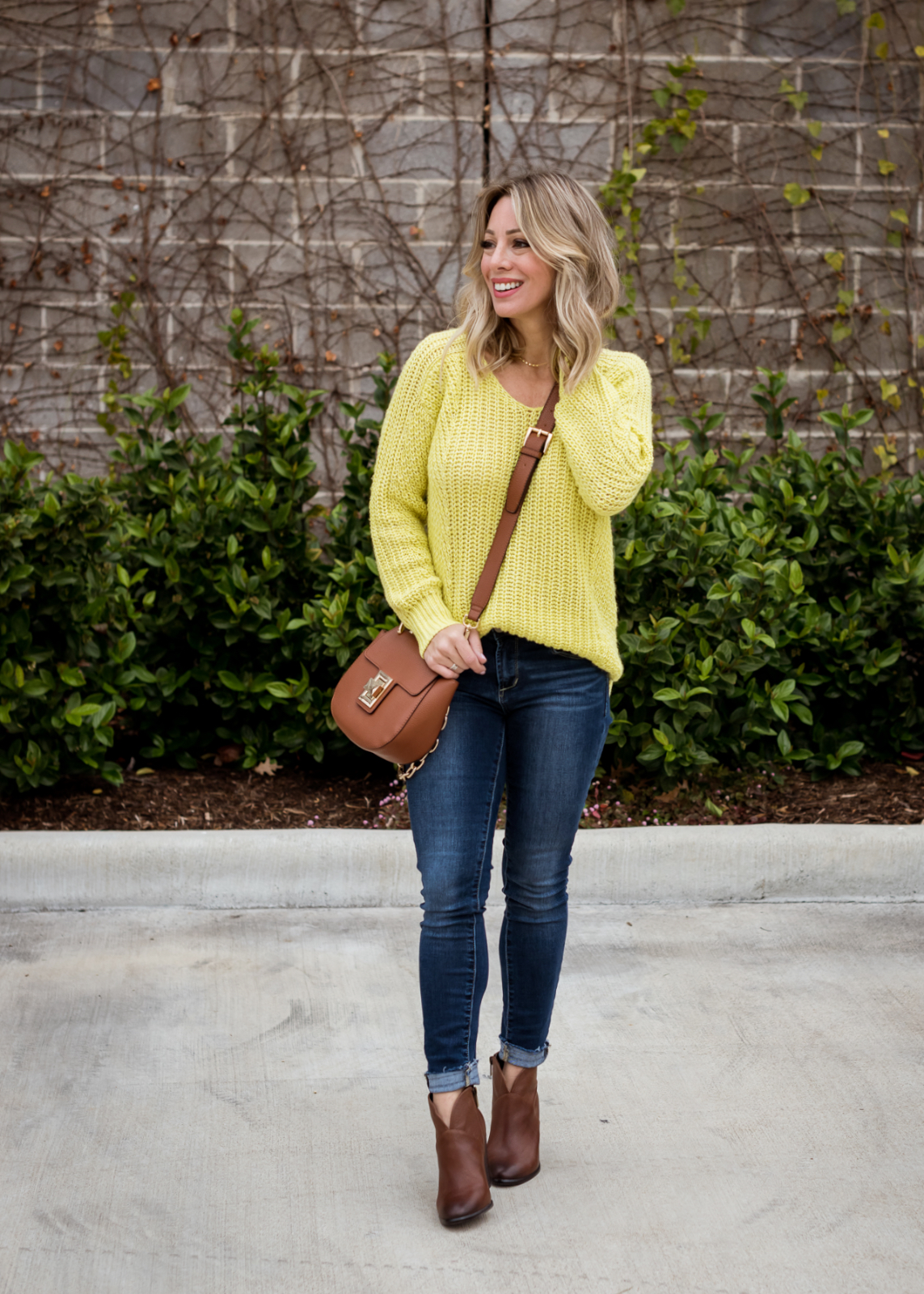 Cute winter outfit - yellow sweater and jeans with brown booties