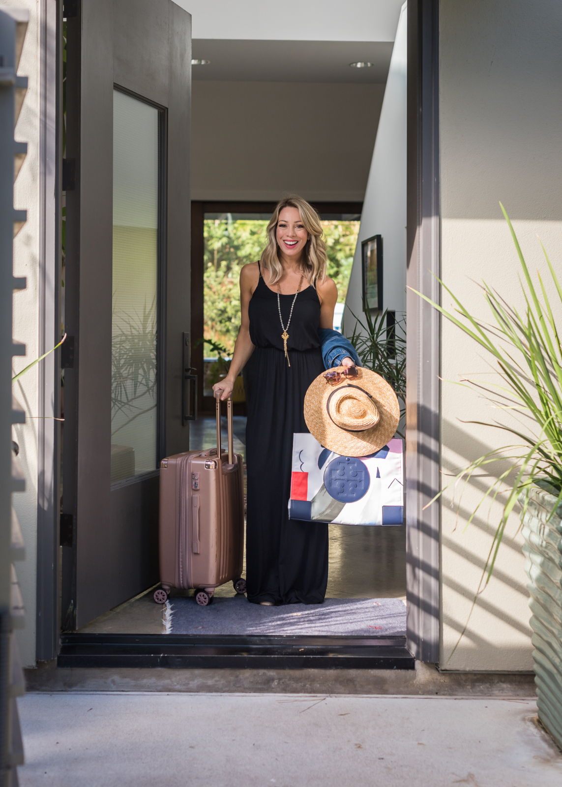 Black maxi and rose gold luggage