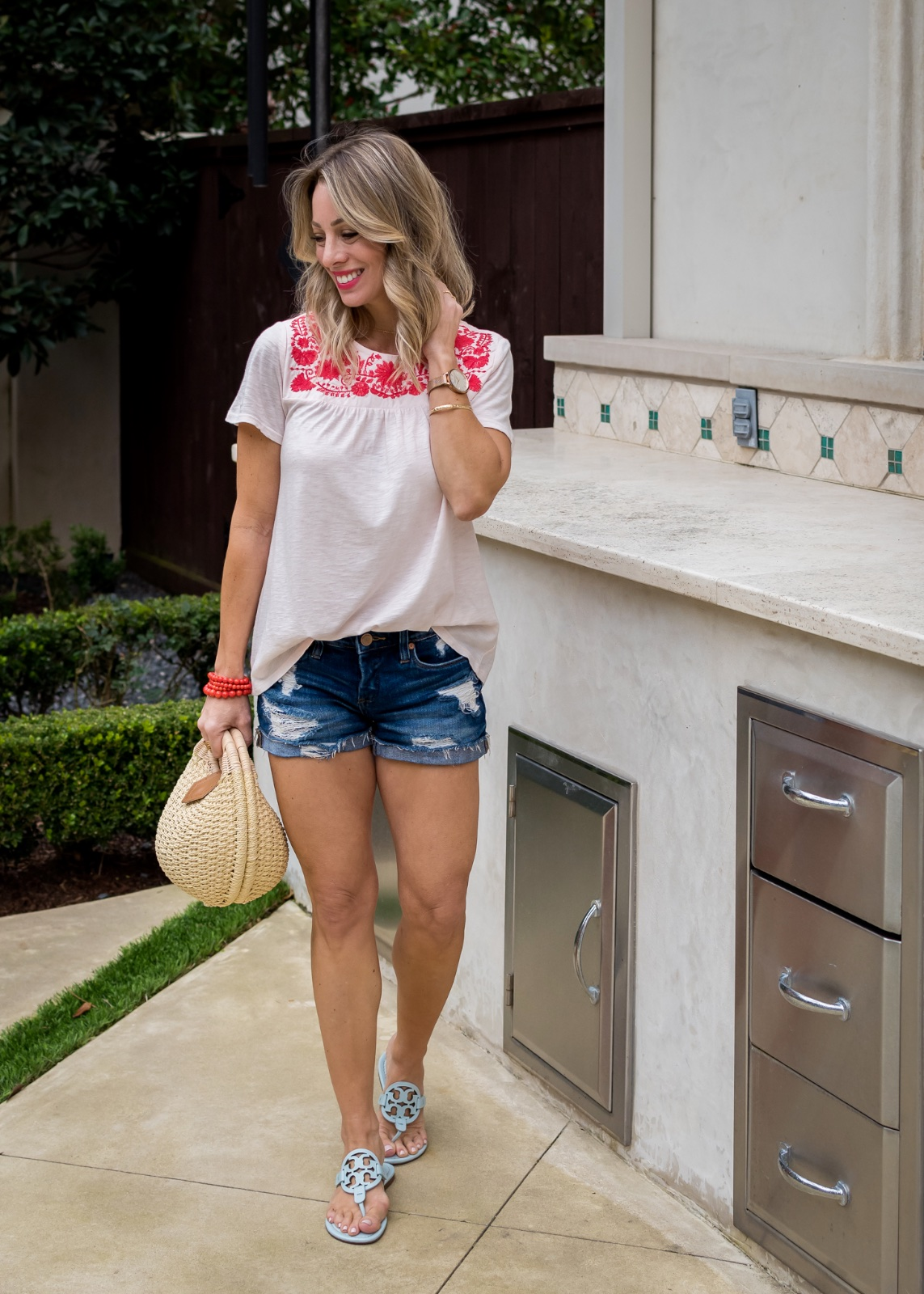 Embroidered tee and jean shorts