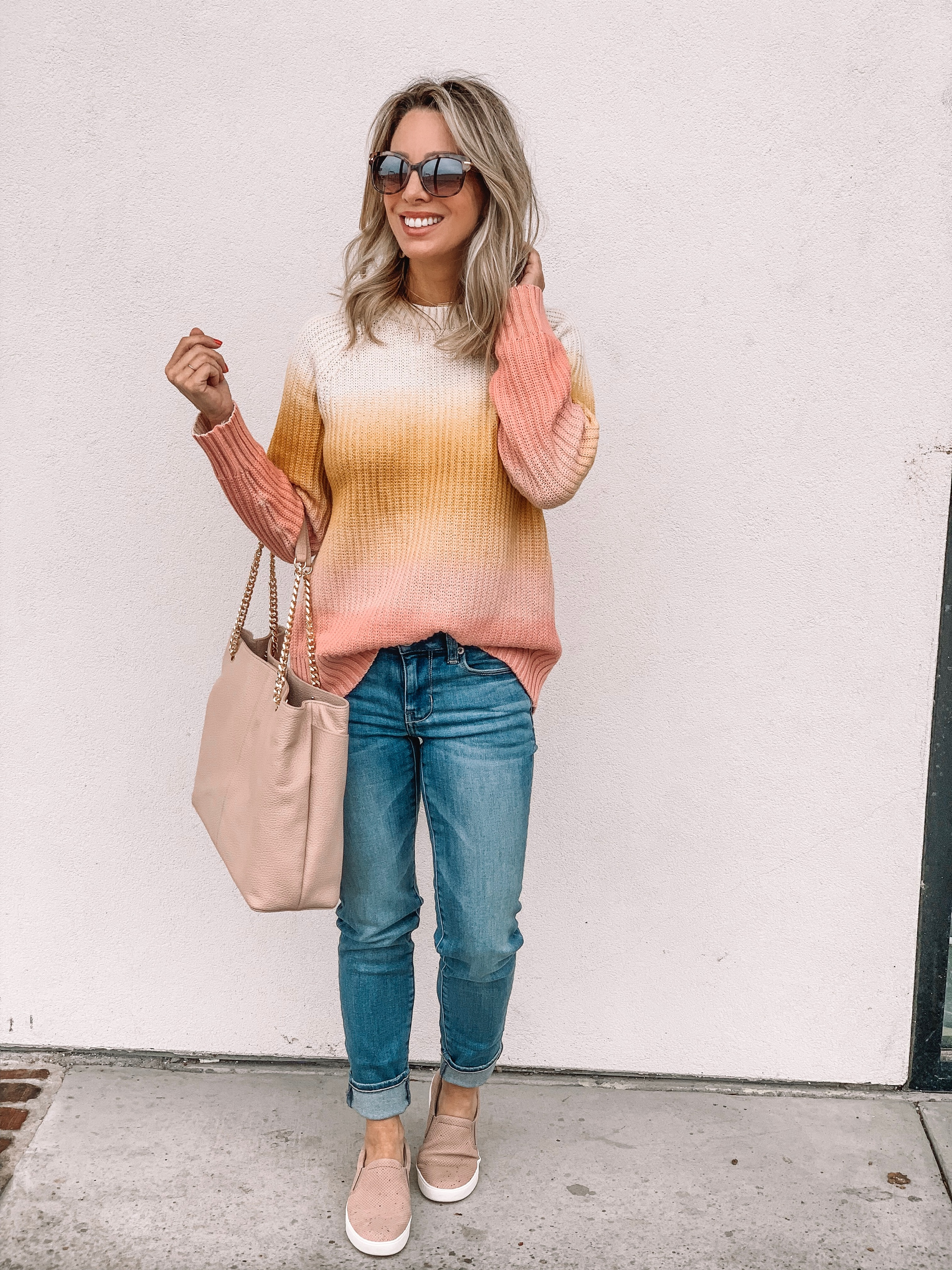 Jeans and striped sweater with pink slip on sneakers