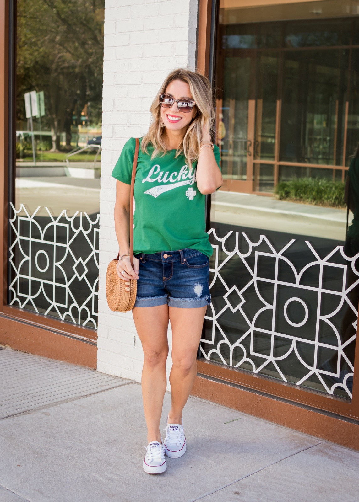 Jean shorts and Lucky t-shirt with converse sneakers
