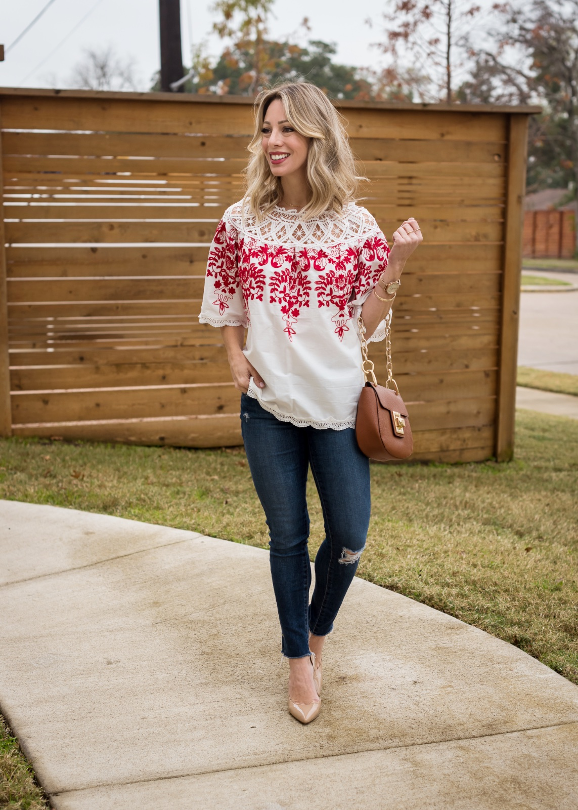 Jeans and red and white embroidered top