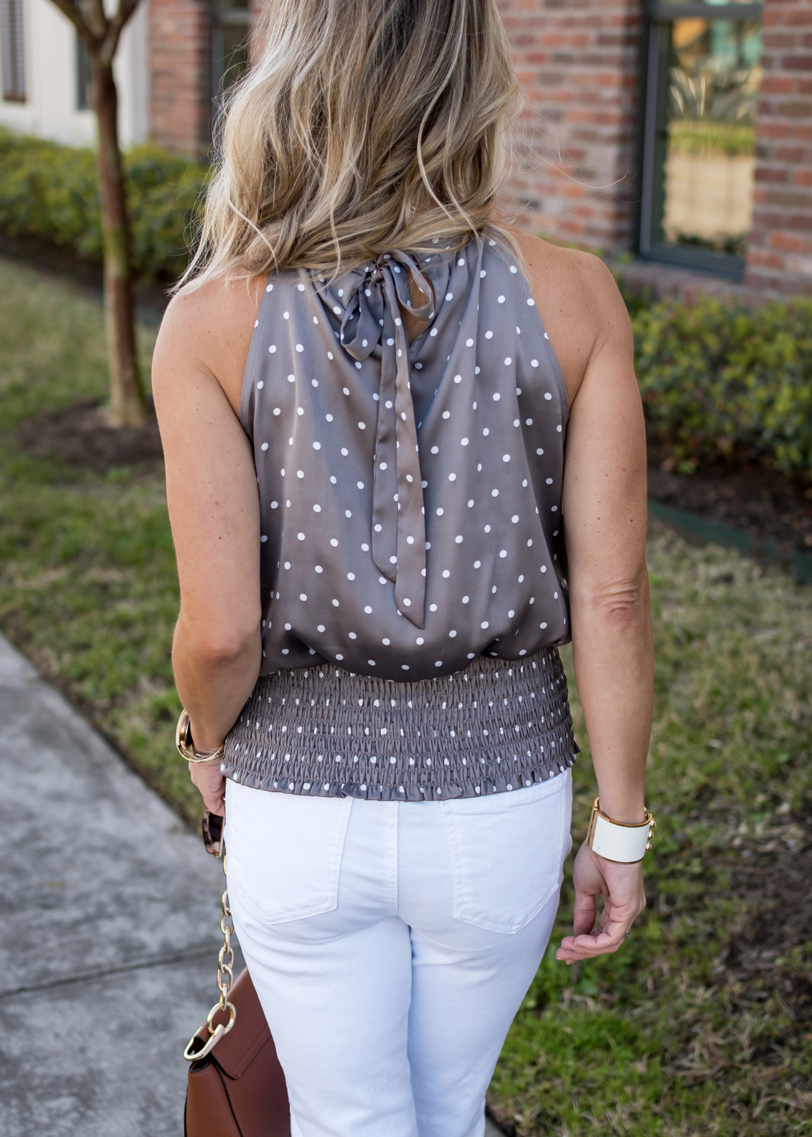 Polka dot halter and white jeans