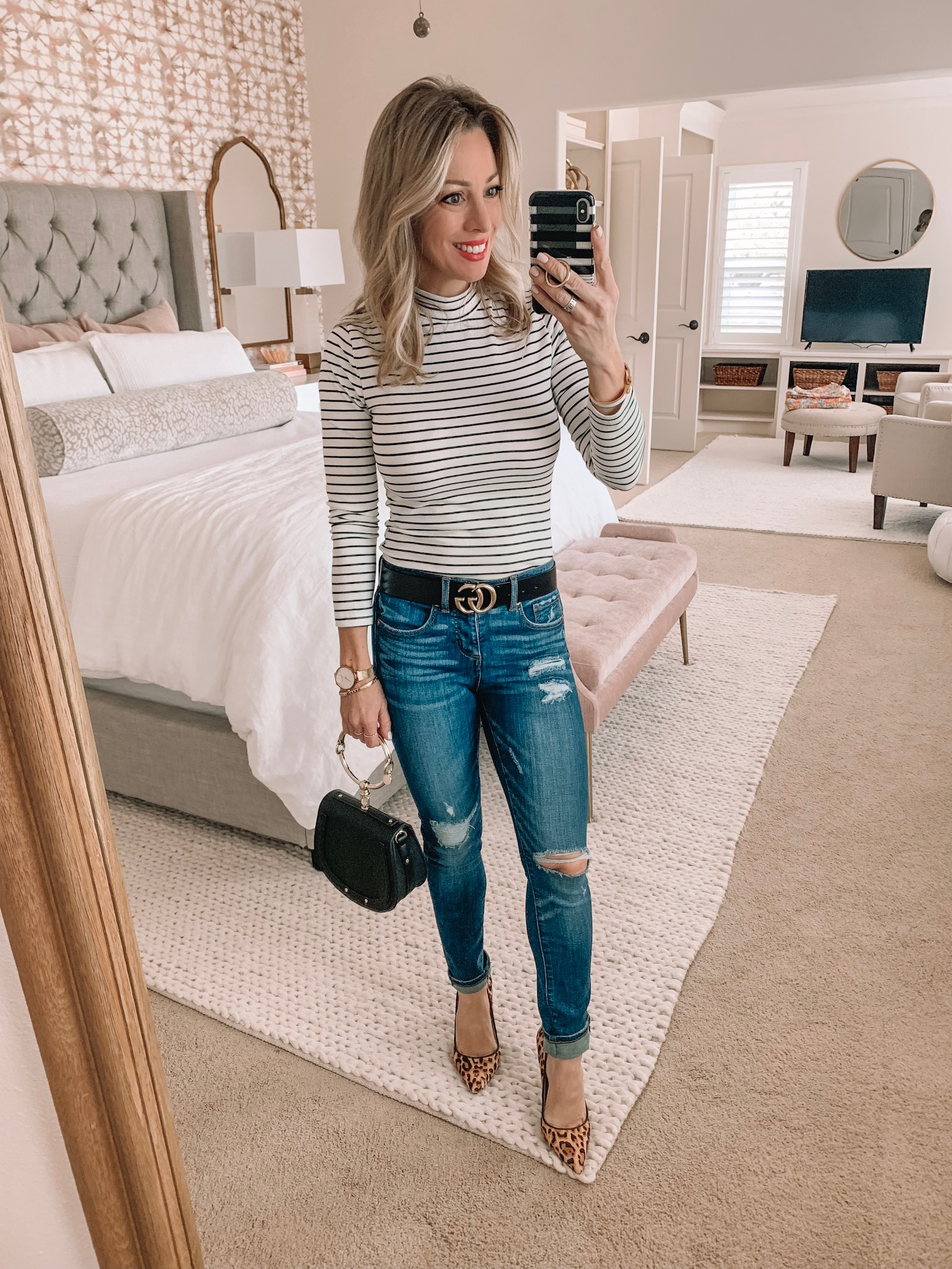 Cute night out outfit - striped top, distressed jeans and leopard heels