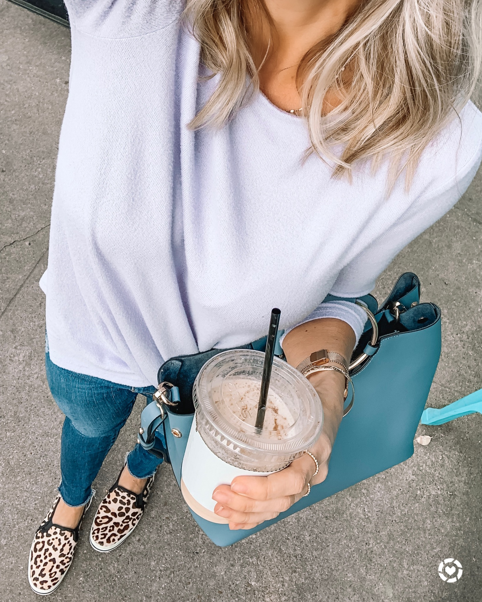 twist pullover and jeans with leopard sneakers