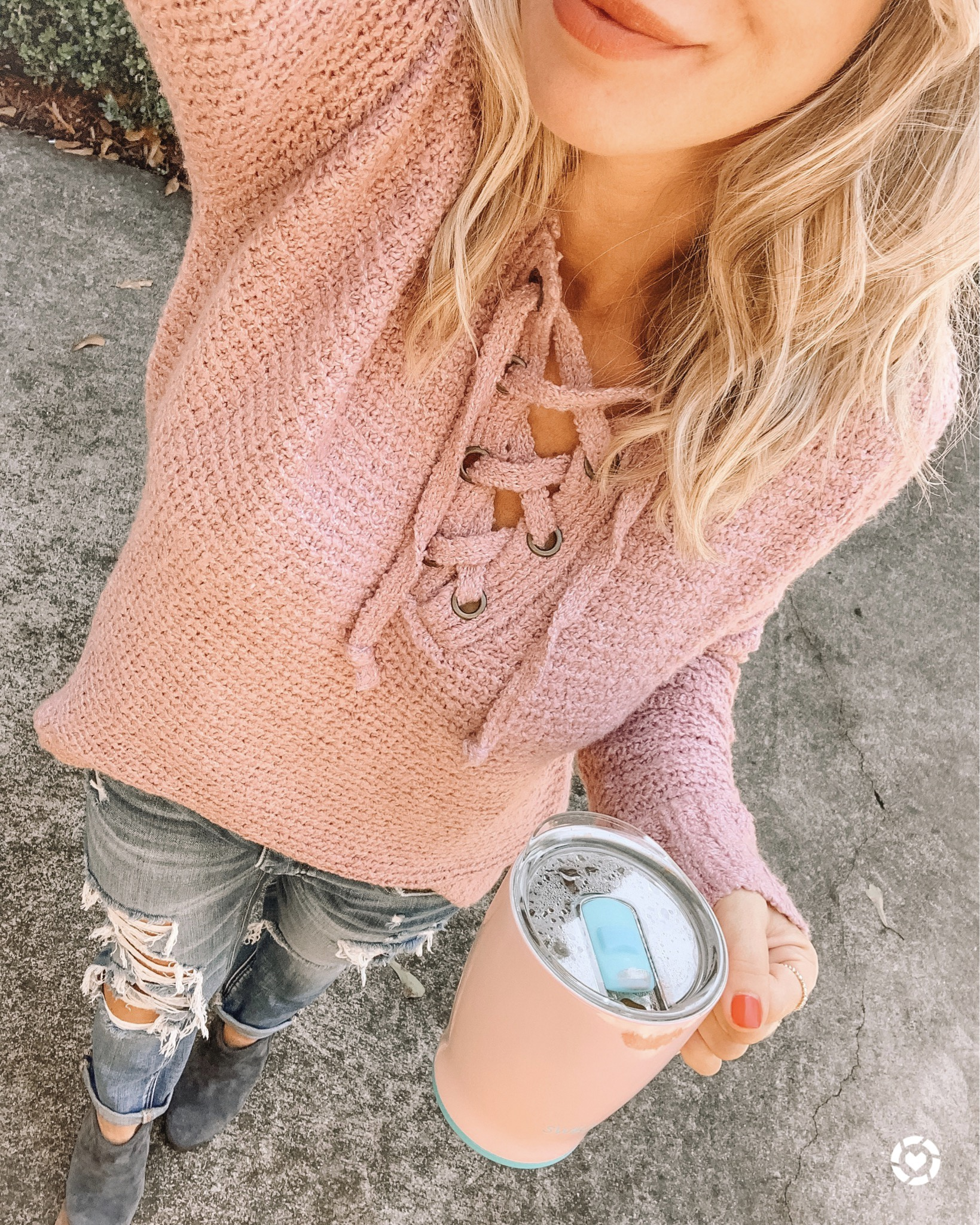 lace up sweater and ripped jeans