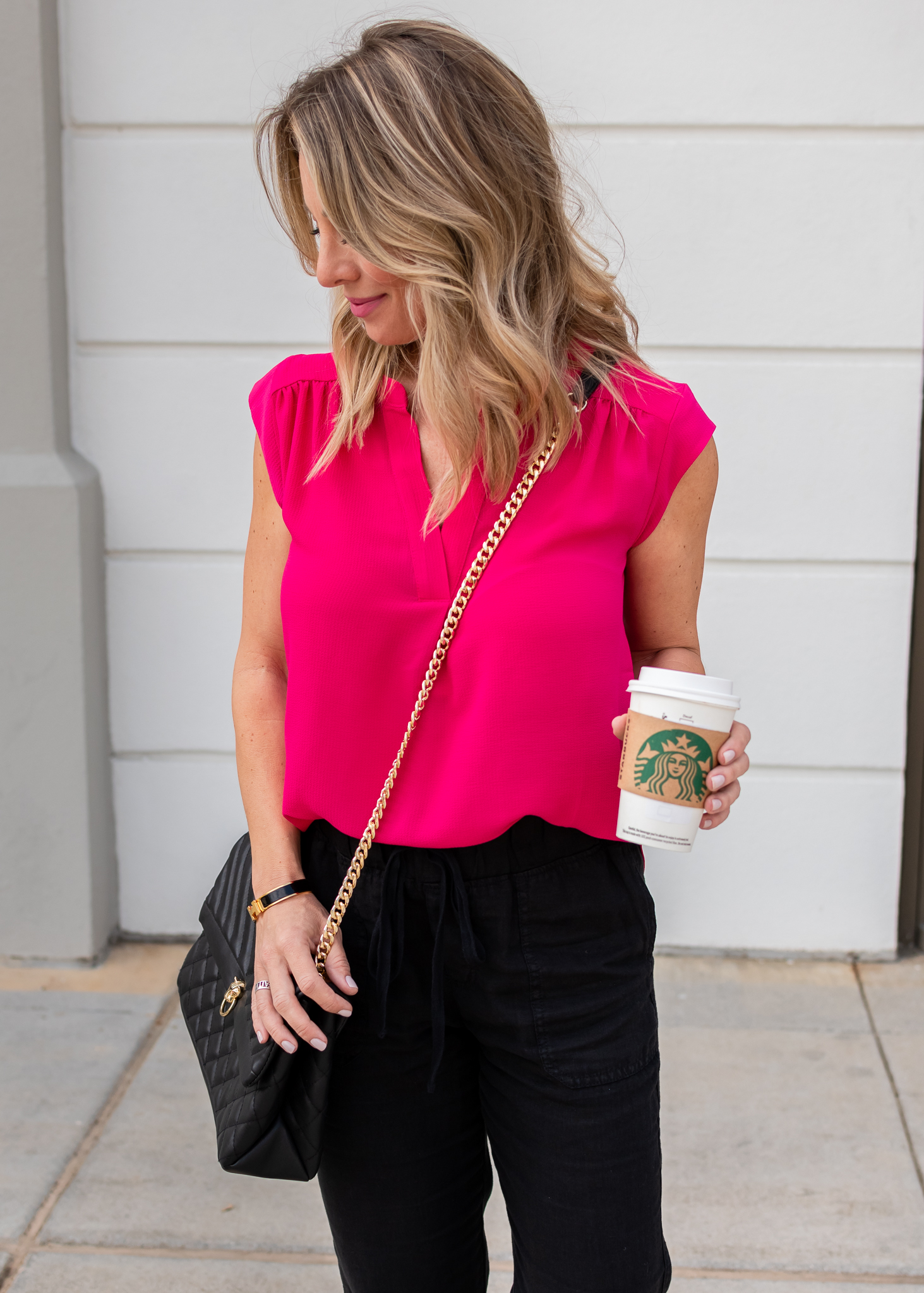 Pink top and black joggers