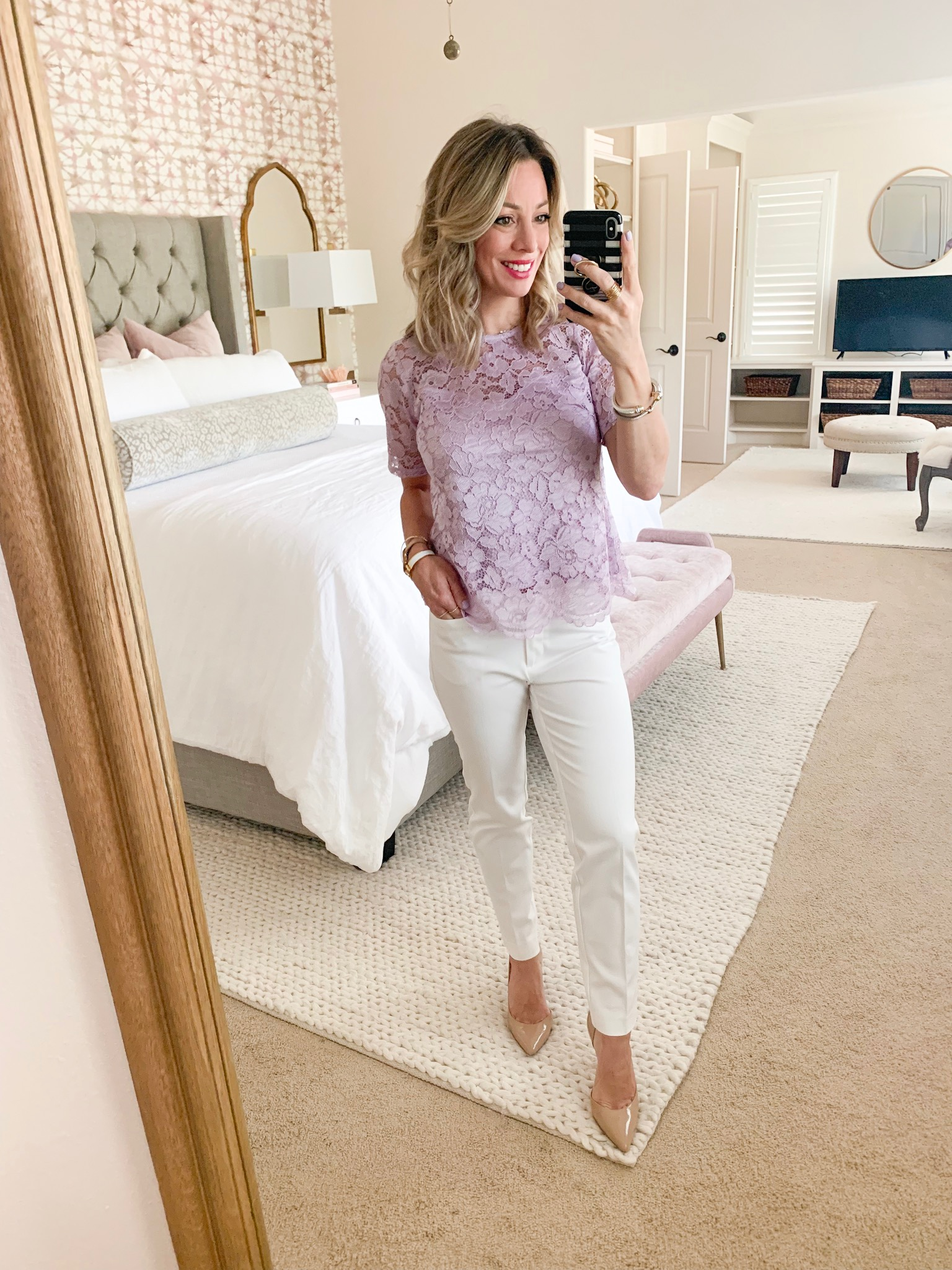 White pants and lavender lace top