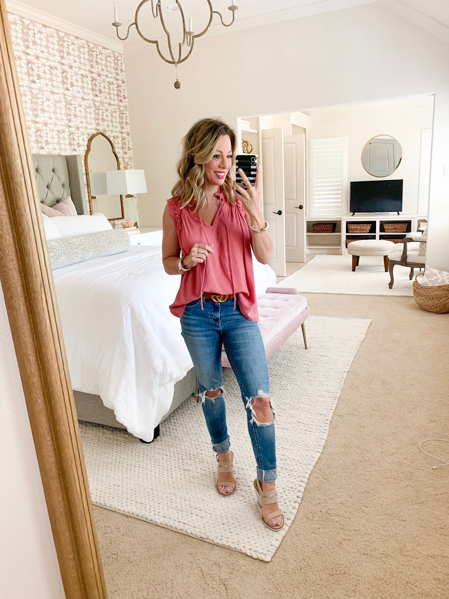 Pink smocked top and ripped knee jeans