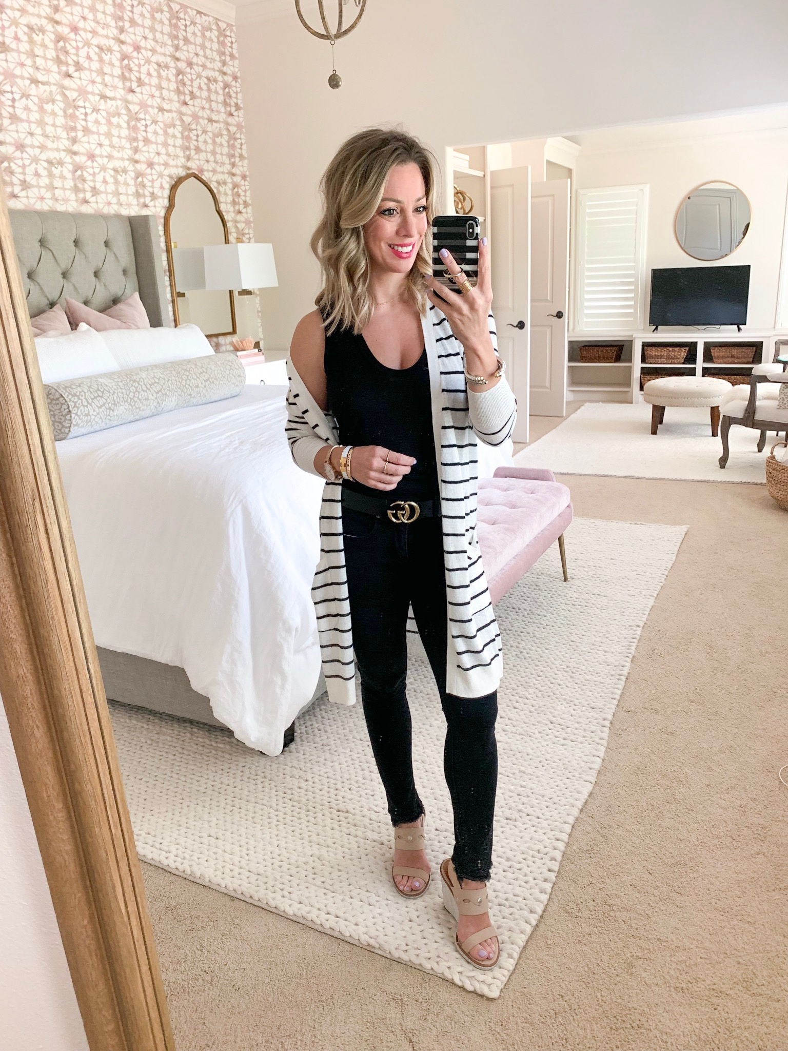 black jeans and striped cardigan