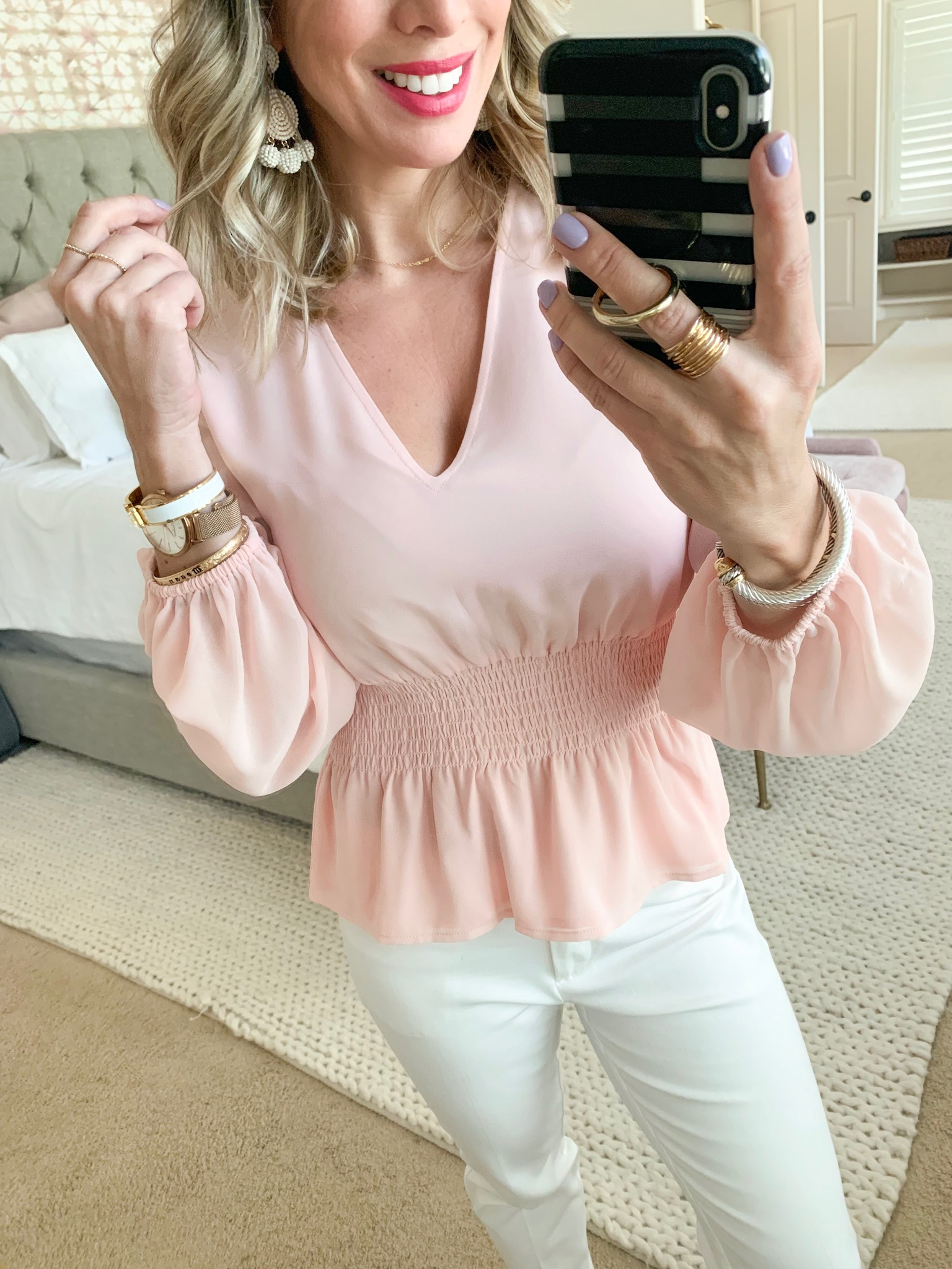 pink chiffon top and white jeans