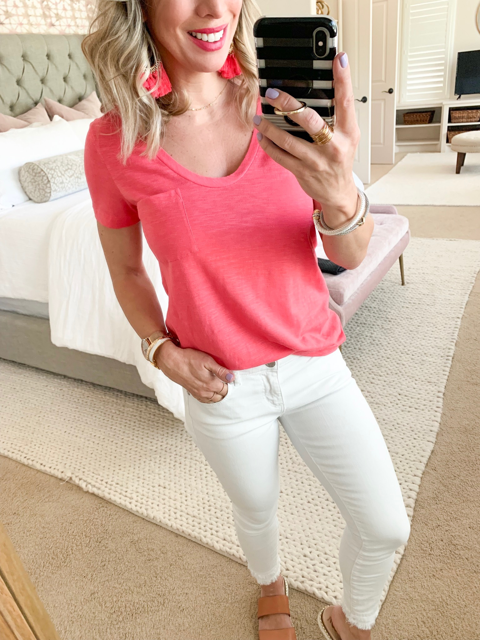 Pink tee and white jeans with slides