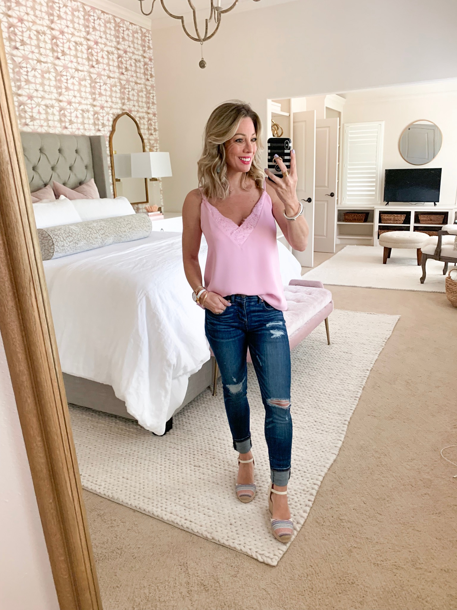 Distressed jeans and pink lace cami