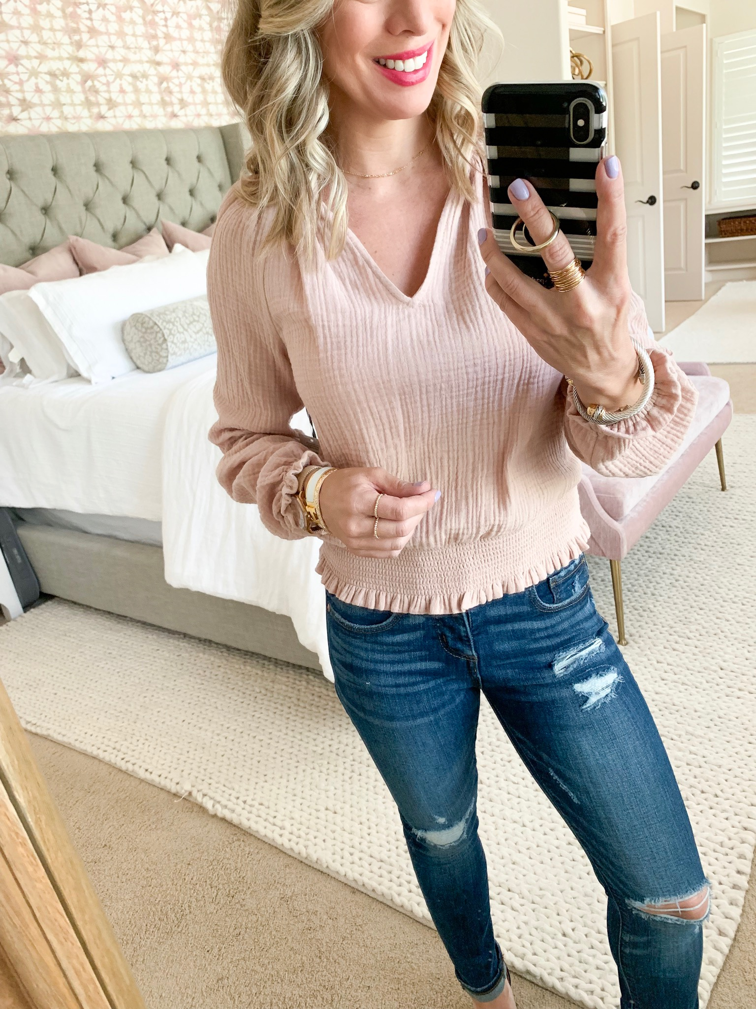Pink smocked top and distressed jeans