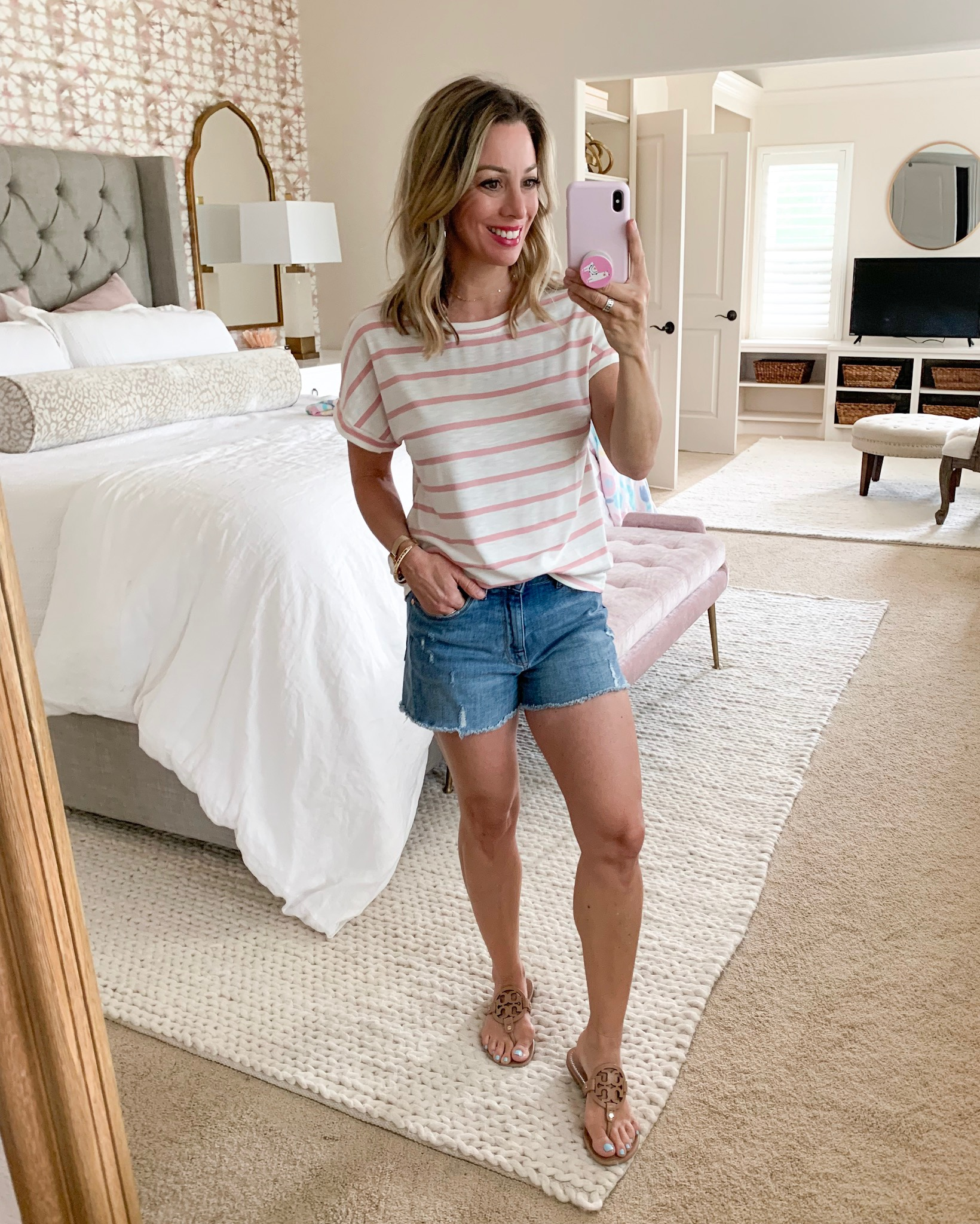 Amazon pink and white striped top and jean shorts