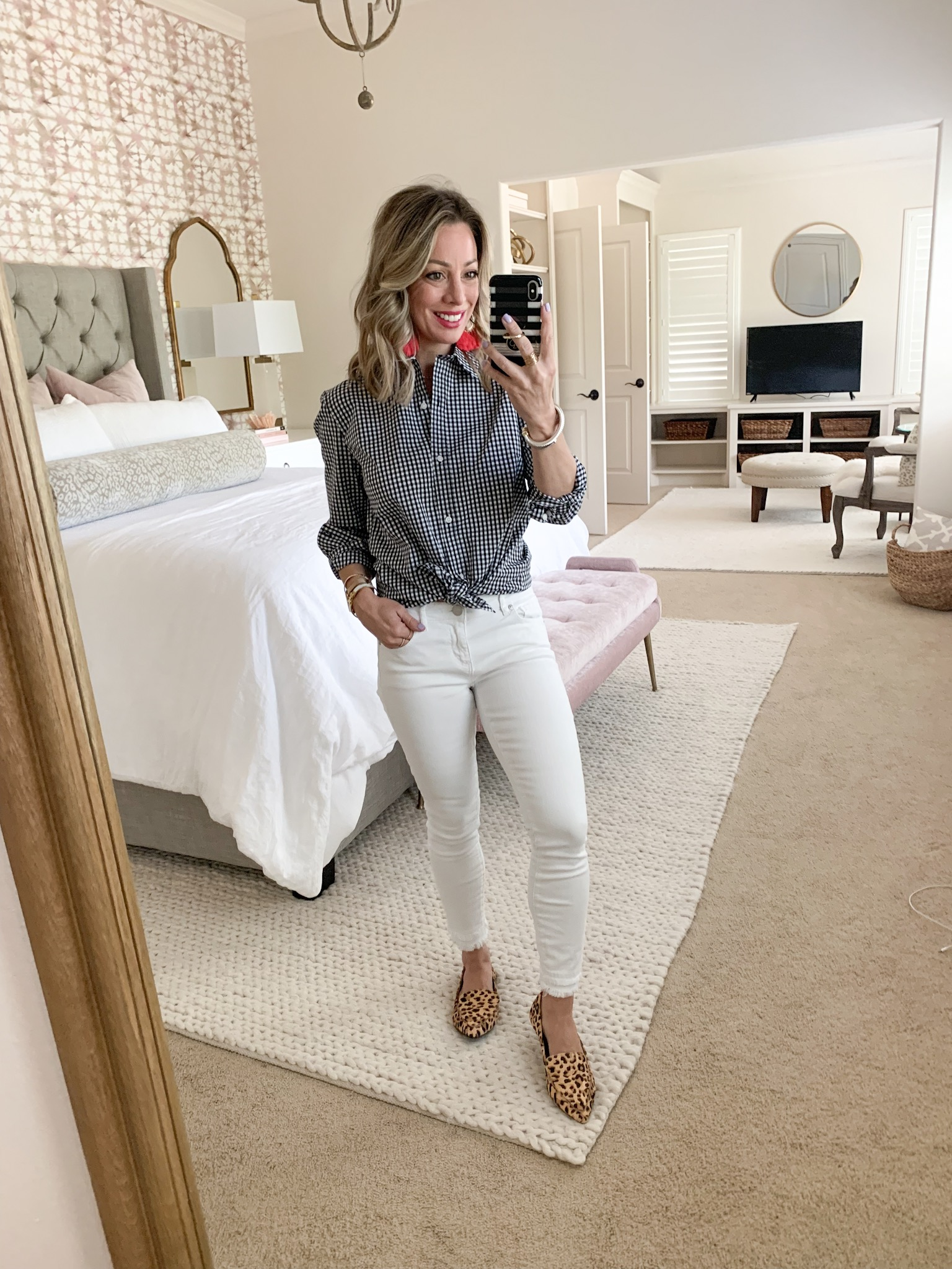 White jeans and black and white check button down