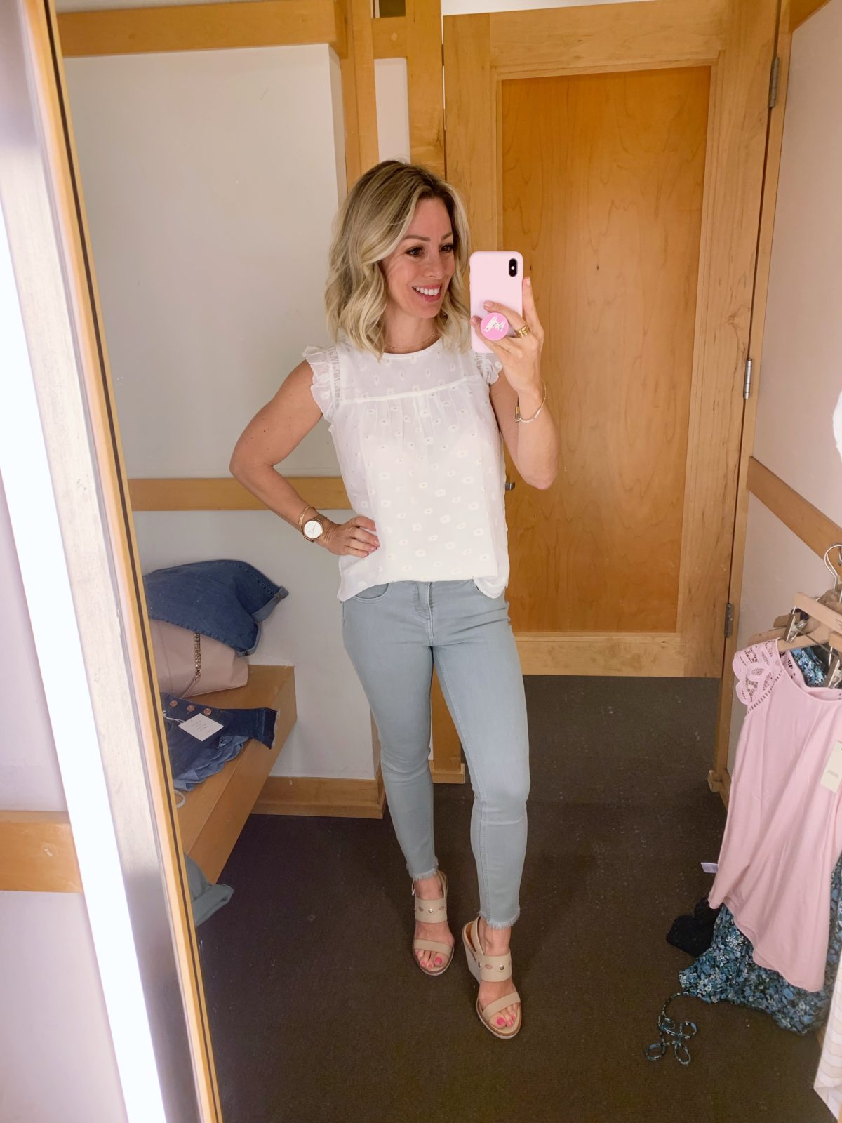 frayed skinny jeans and white blouse