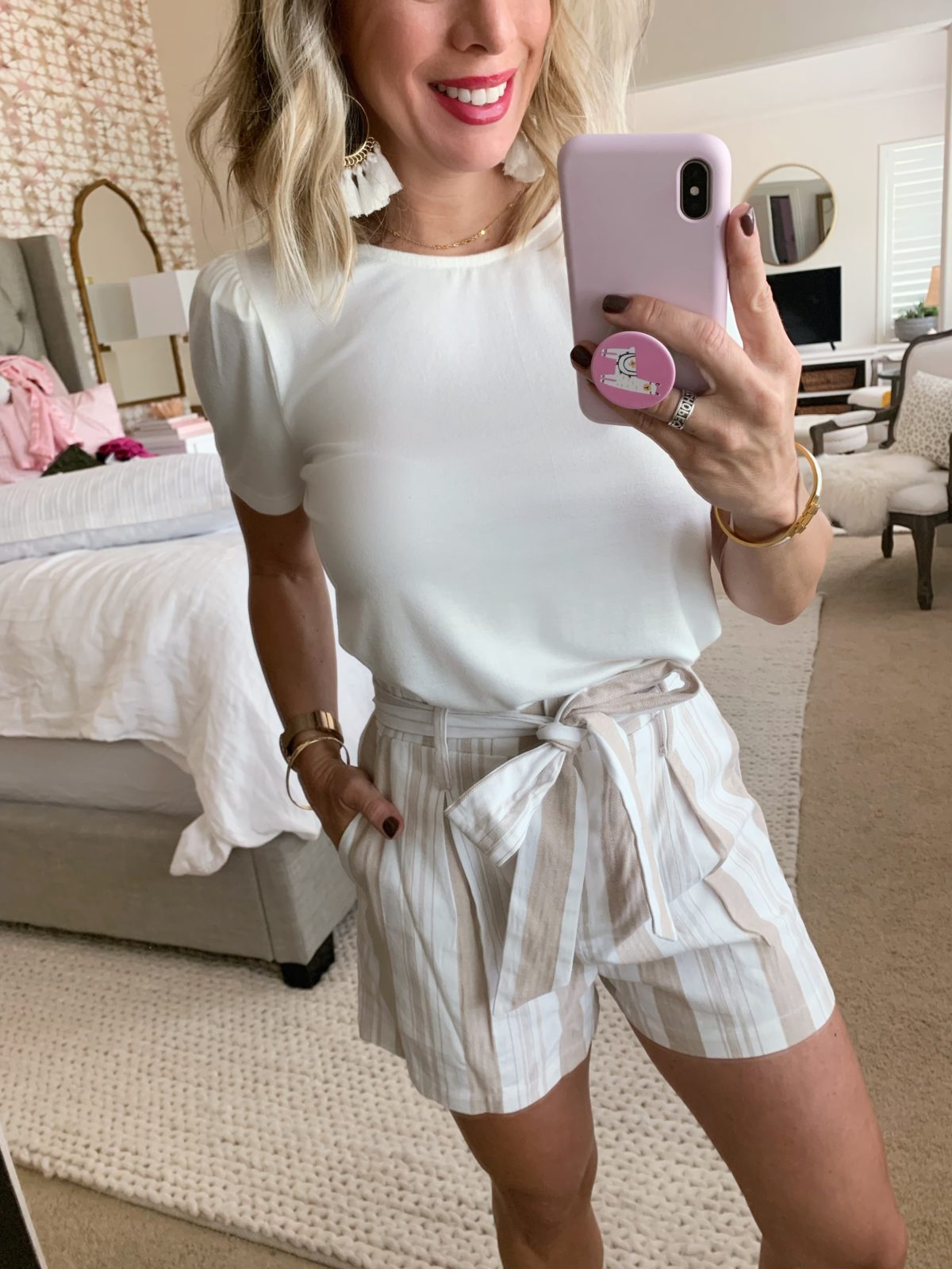 belted paper bag shorts and white tee