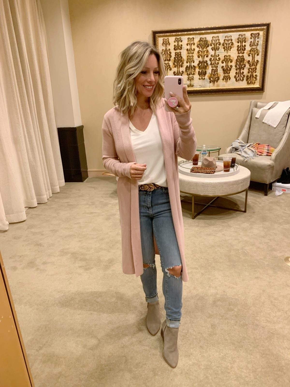 Nordstrom Anniversary Sale - white top with Jeans and boots and a pink cardigan