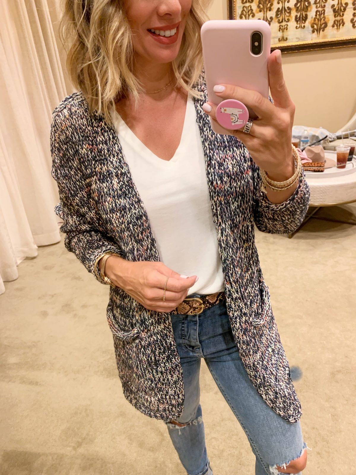 Nordstrom Anniversary Sale - white top and a rainbow cardigan with Jeans and boots