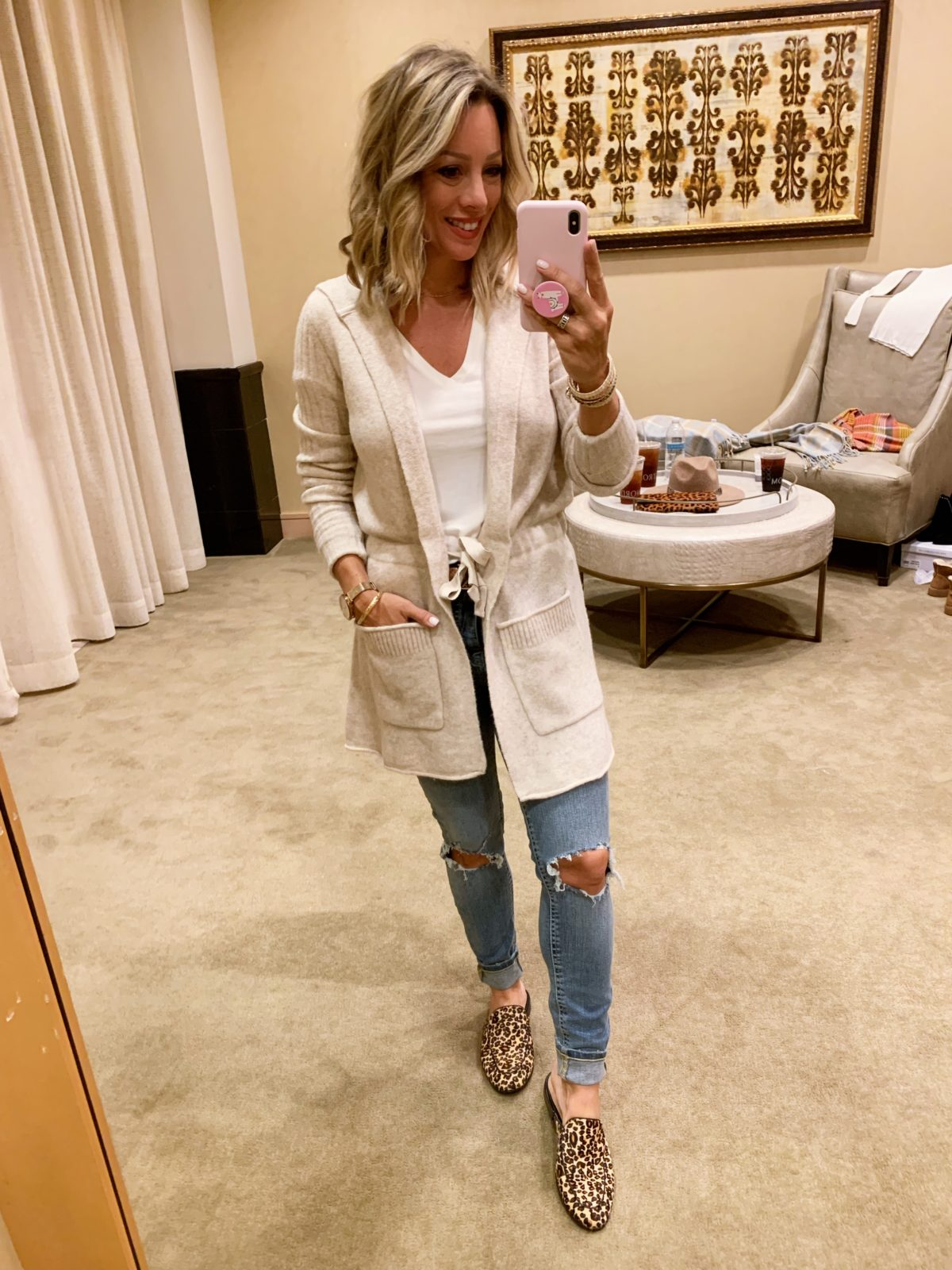 Nordstrom Anniversary Sale - white top with Jeans and boots and a cream cardigan