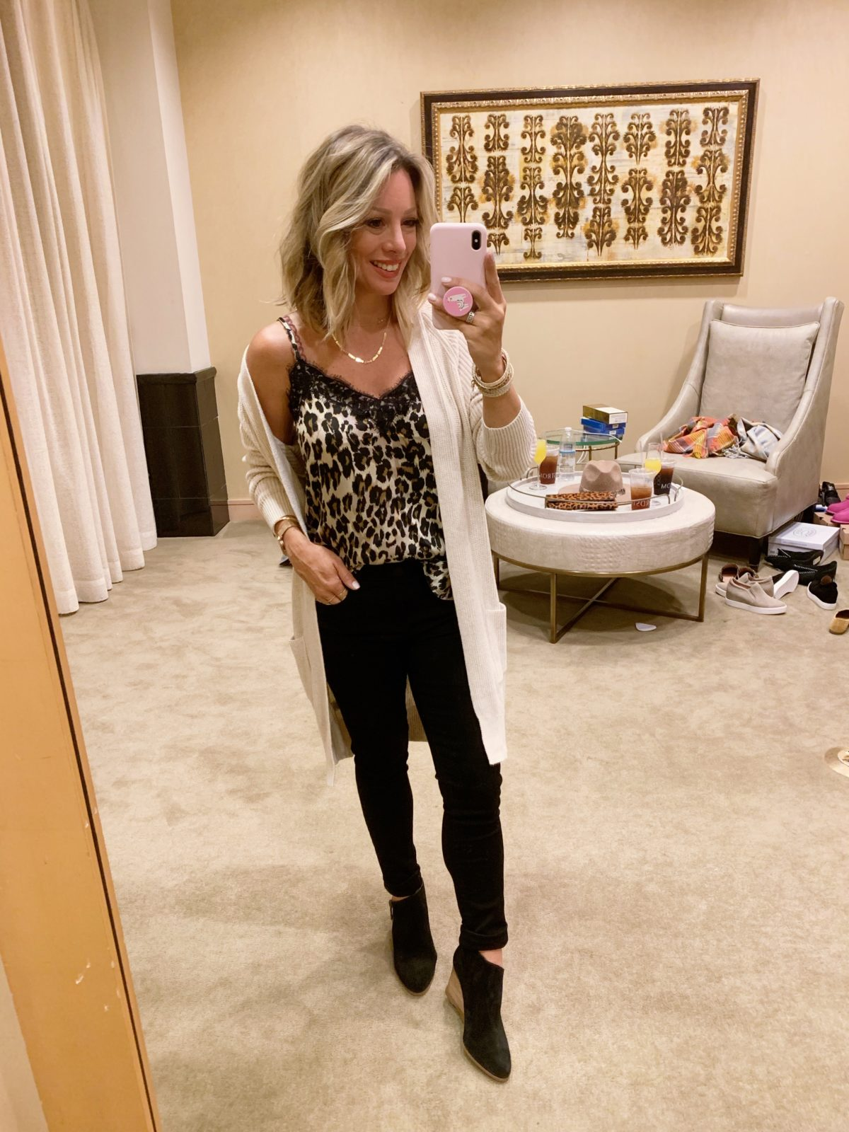Nordstrom Anniversary Sale - leopard cami with a cream cardigan and black jeans with black boots