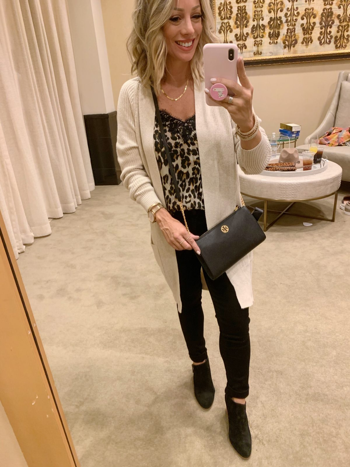 Nordstrom Anniversary Sale - leopard cami with a cream cardigan and black jeans with black boots with a Tory Burch crossbody