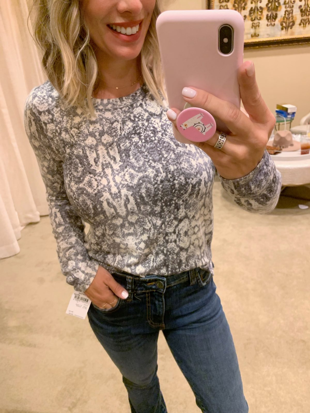 Nordstrom Anniversary Sale - snakeskin long sleeve shirt with boot cut jeans and boots