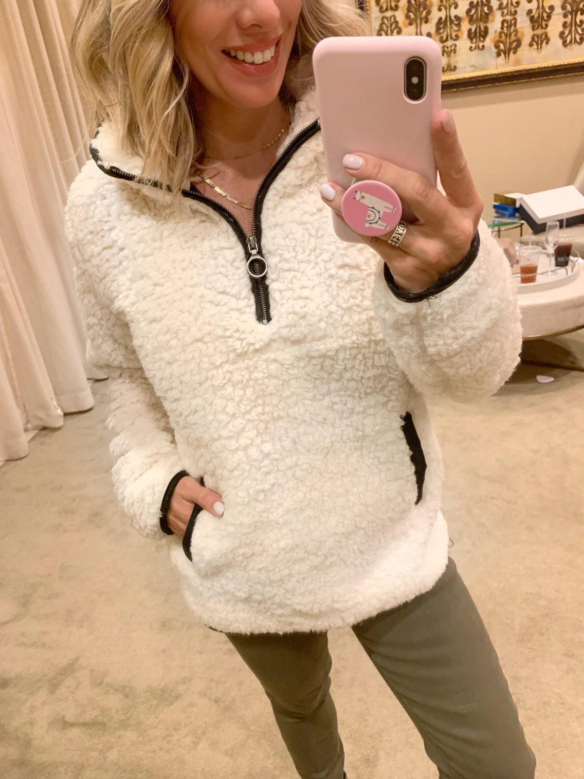 Nordstrom Anniversary Sale - white fluffy pullover with army green pants and black sneakers