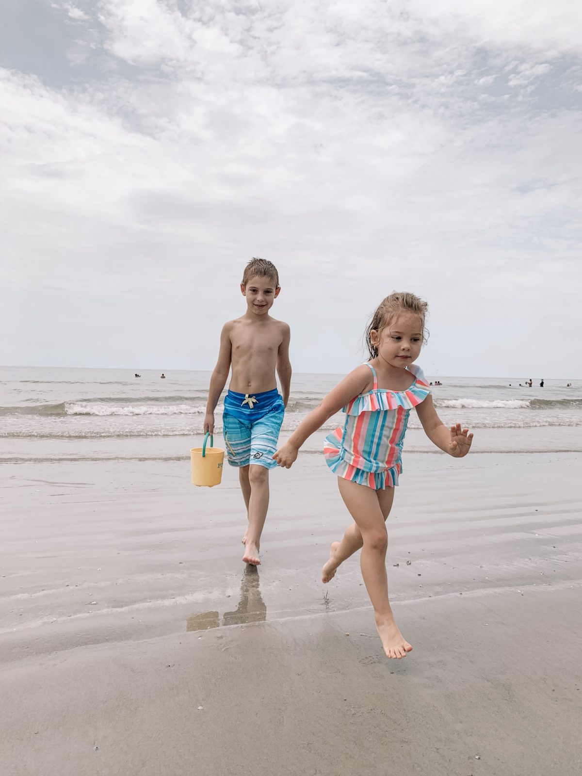 48 Hours in Galveston - siblings playing in the beach