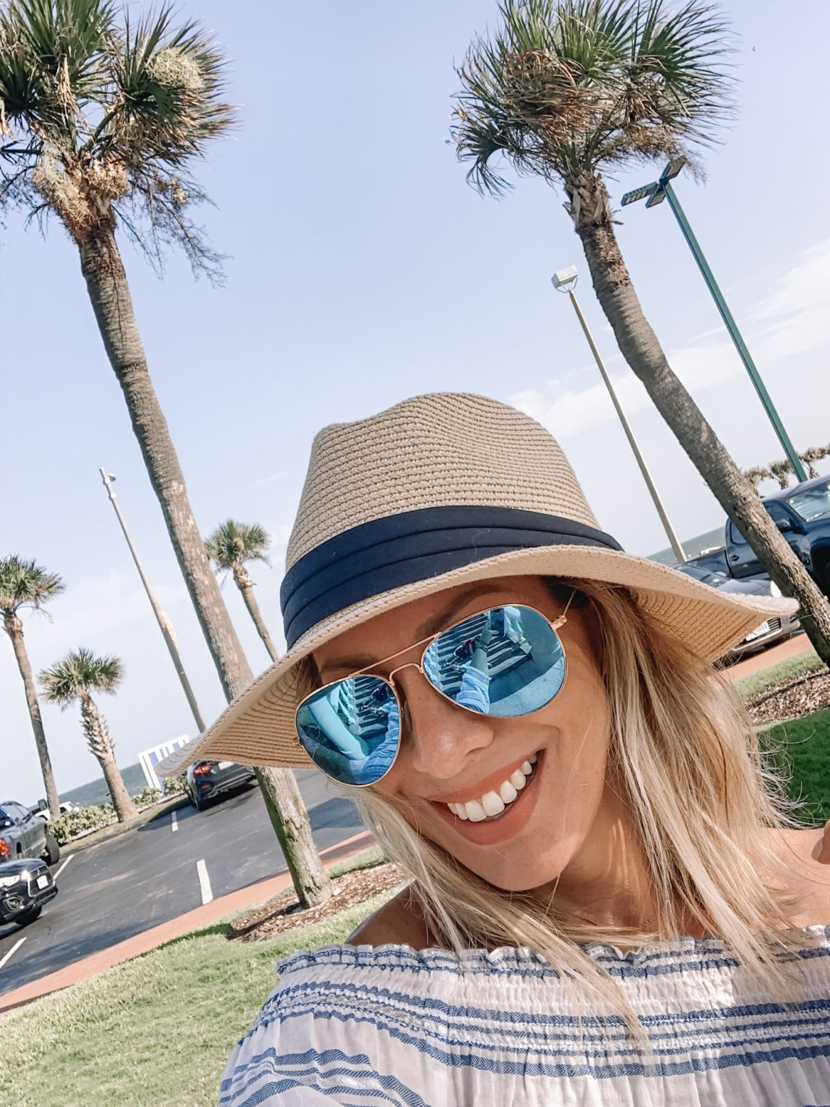 48 Hours in Galveston - stripe shirt with a beach hat