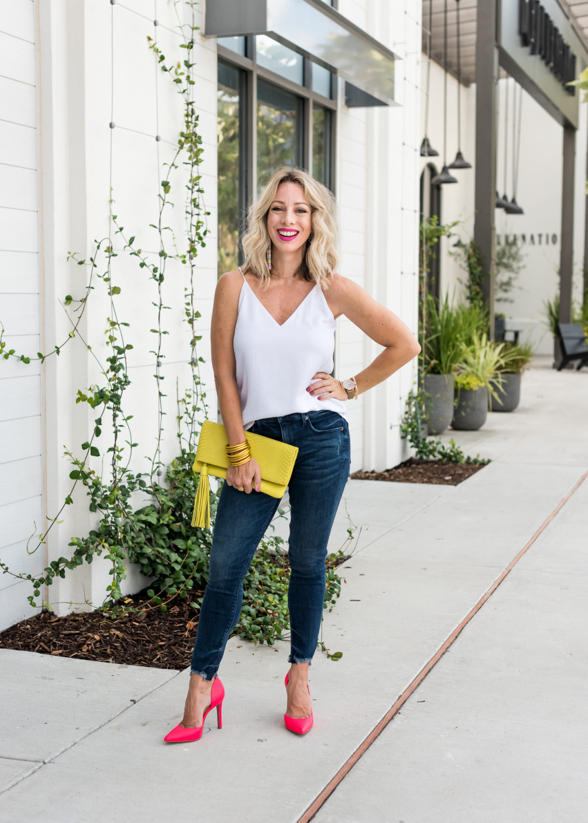Jeans and cami with neon shoes and bag