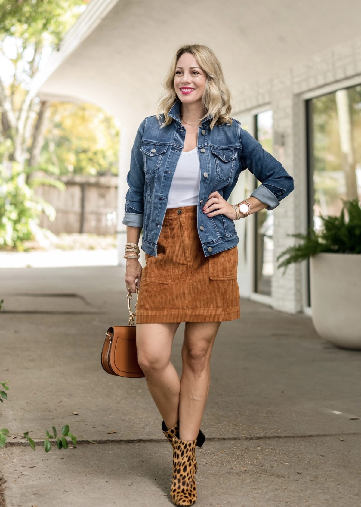 white t-shirt with corduroy skirt and jean jacket