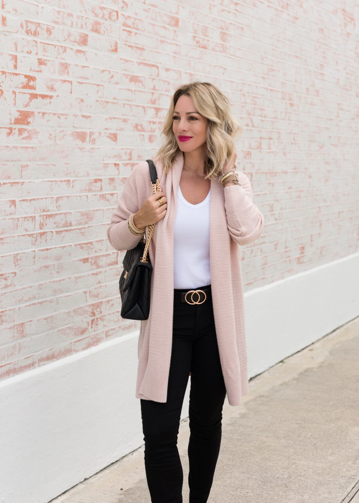 white t-shirt with black jeans and pink cardigan