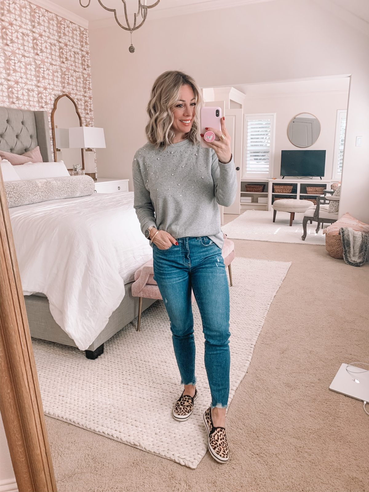 pearl sweatshirt jeans and leopard sneakers