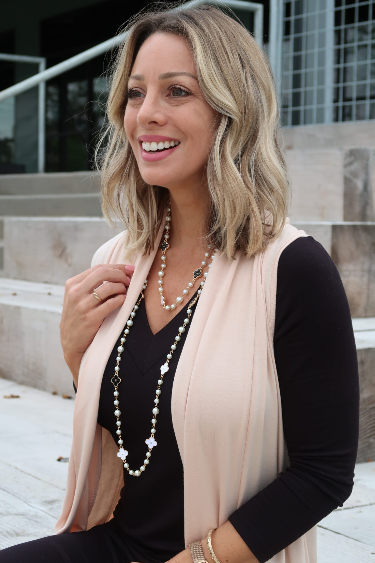Pink Cardigan, Black Dress, Pearl Clover Necklace