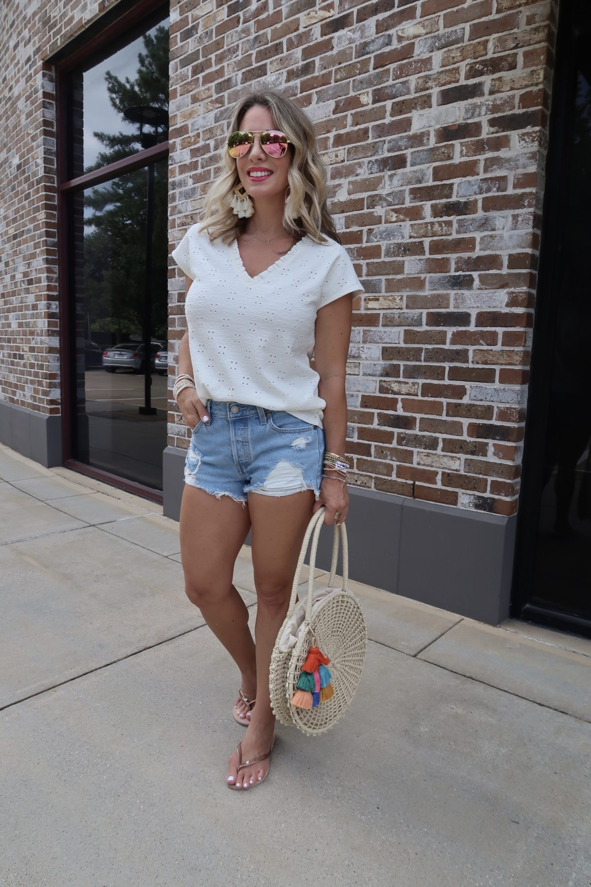New Summer Styles, White Eyelet Top, Blue Jeans Shorts, Flip Flops, Woven Circle Bag with Tassel